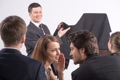 Young beautiful brunette talking to man. Royalty Free Stock Images