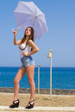Young beautiful brunette with white umbrella Stock Images