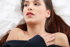 Young and beautiful brunette woman on bed Stock Images