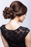 Young beautiful brunette woman in black dress Stock Photo