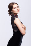 Young beautiful brunette woman in black dress Royalty Free Stock Photos