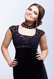 Young beautiful brunette woman in black dress Stock Photography