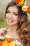 Young beautiful brunette woman in blooming garden Stock Photography