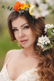 Young beautiful brunette woman in blooming garden Stock Images