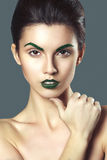 Young beautiful brunette woman with creative crystal make up Stock Photos