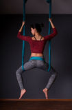 Young beautiful brunette woman doing fly yoga. Sitting in hammoc Royalty Free Stock Photo