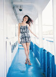Young beautiful brunette woman in dress on the ship deck Royalty Free Stock Photo