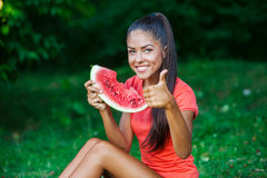 Young beautiful brunette woman eating watermelon Royalty Free Stock Image
