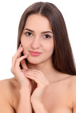 Young beautiful brunette woman face portrait with healthy skin. Isolated background Stock Photography
