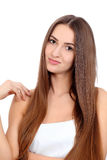 Young beautiful brunette woman face portrait with healthy skin. Isolated background Royalty Free Stock Photo