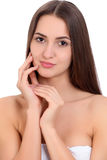 Young beautiful brunette woman face portrait with healthy skin. Isolated background Royalty Free Stock Photos