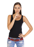 Young beautiful brunette woman has put forefinger to lips as sig Royalty Free Stock Image