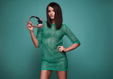 Young beautiful brunette woman with headphones Royalty Free Stock Images