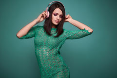Young beautiful brunette woman with headphones Stock Image