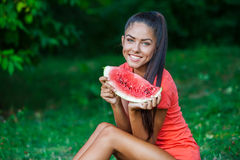 Young beautiful brunette woman holding watermelon Stock Photos