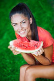 Young beautiful brunette woman holding watermelon Stock Photo