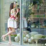 Young Beautiful Brunette Woman In White Flowers Dress Walking On Stock Photography