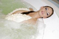 Young beautiful woman in jacuzzi Stock Photos