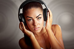 Young beautiful brunette woman listening music Stock Image