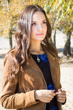 Young beautiful brunette woman in park, outdoor autumn portrait Royalty Free Stock Photos