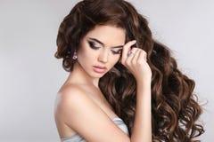 Young beautiful brunette woman portrait. Beauty makeup. Fashion Stock Images