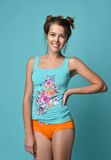 Young beautiful brunette woman posing in modern cloth isolated o Royalty Free Stock Photography