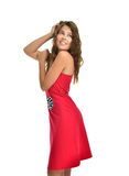 Young beautiful brunette woman posing in modern red dress Stock Image