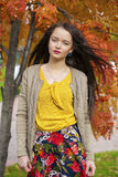 Young beautiful brunette woman posing outdoors in autumn park Stock Photo