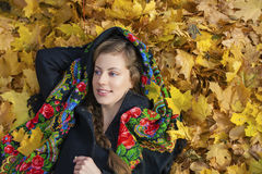Young beautiful brunette woman posing outdoors in autumn park Royalty Free Stock Image