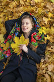 Young beautiful brunette woman posing outdoors in autumn park Royalty Free Stock Photography