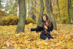 Young beautiful brunette woman posing outdoors in autumn park Stock Images