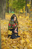Young beautiful brunette woman posing outdoors in autumn park Royalty Free Stock Photos