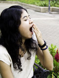 Young beautiful brunette woman yawning Royalty Free Stock Photos