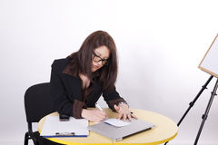 Young beautiful business woman. Working at the office Royalty Free Stock Photos