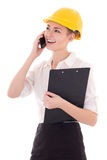 Young beautiful business woman architect in builder helmet talki Stock Photos