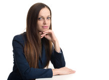 Young beautiful business woman behind the desk Royalty Free Stock Photos