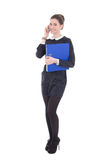 Young beautiful business woman in black dress with blue folder i. Solated on white background royalty free stock photo