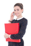 Young beautiful business woman in black dress with blue folder t. Alking by phone isolated on white background Stock Photography