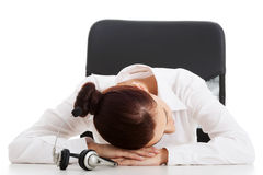 Young beautiful business woman on call center is sleeping on tab Royalty Free Stock Photo