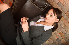 Young beautiful business woman in chair Royalty Free Stock Image