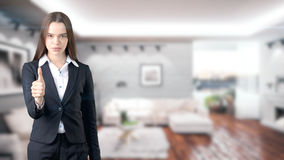 Young beautiful business woman and creative designer standing over blured interior background. Concepr of succesful architect stock photography