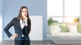 Young beautiful business woman and creative designer standing over blured interior background. Concepr of succesful architect stock photos