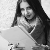 Young beautiful business woman with documents in her hands outdo Stock Image