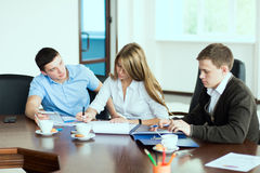 Young beautiful business woman executive with business partners, Stock Images