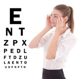 Young beautiful business woman in glasses and eye test chart iso. Lated on white background Stock Photo