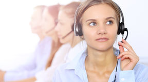 Young beautiful business woman in headset. Call center operator. Royalty Free Stock Images