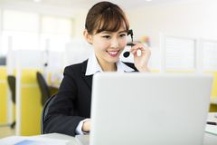 Young beautiful  business woman with headset Stock Photo