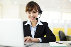 Young beautiful  business woman with headset Royalty Free Stock Photos