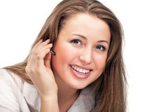 Young beautiful business woman with headsetling Royalty Free Stock Images