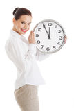 Young beautiful business woman holding clock. Stock Photo